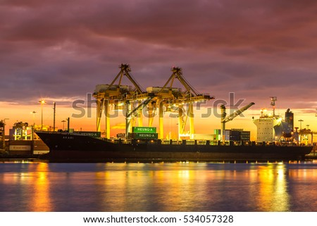 Bangkok,Thailand - November 26, 2016 : Bangkok Port Authority of Thailand ,The port in Bangkok with loadfreight ship and cargo handling equipment on the side of Chao Phraya river in Bangkok,Thailand.