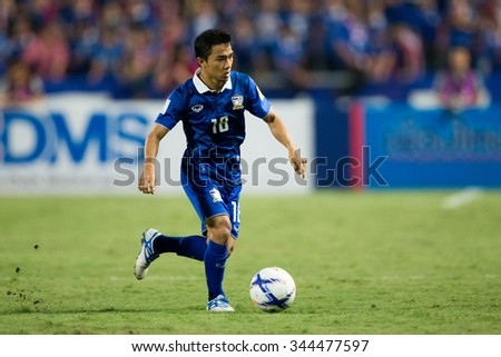 BANGKOK,THAILAND NOVEMBER 12:Chanathip Songkrasin(blue)of Thailand in action during the 2018 FIFA World Cup Qualifier Thailand and Chinese Taipei  at Rajamangala Stadium on Nov12, 2015 inThailand.