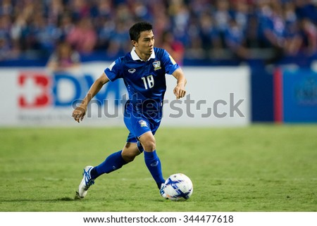 BANGKOK,THAILAND NOVEMBER 12:Chanathip Songkrasin of Thailand run with the ball during the 2018 FIFA World Cup Qualifier Thailand and Chinese Taipei  at Rajamangala Stadium on Nov12, 2015 inThailand. - stock photo