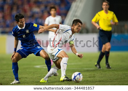 BANGKOK,THAILAND NOVEMBER 12:Chen Po-liang (R)of Chinese Taipei  in action during the 2018 FIFA World Cup Qualifier Thailand and Chinese Taipei  at Rajamangala Stadium on Nov 12, 2015 in Thailand.