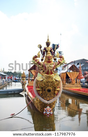 BANGKOK,THAILAND-NOVEMBER 6:Decorated barge parades past the Grand Palace at the Chao Phraya River during rehearsal of Royal Barge Procession on Nov. 6, 2012. in Bangkok, Thailand