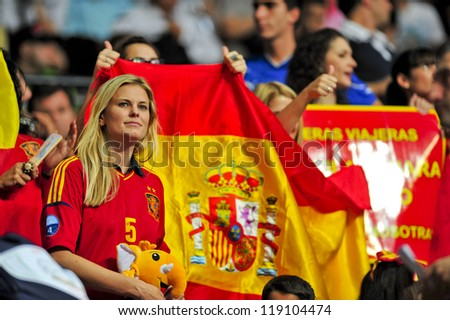 BANGKOK, THAILAND - NOVEMBER 14: Fan Club of Spain in the FIFA Futsal World Cup, Quarter-Final match between Spain and Russia at Nimibutr Stadium on November 14, 2012 in Bangkok, Thailand. - stock photo