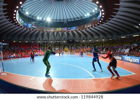 BANGKOK,THAILAND-NOVEMBER 09: Goalkeeper Hema (green) of Egypt in action during the FIFA Futsal World Cup between Kuwait and Egypt at Indoor Stadium Huamark on Nov9, 2012 in Bangkok, Thailand. - stock photo