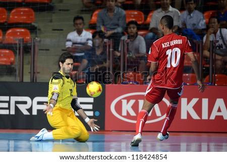 BANGKOK,THAILAND-NOVEMBER 05:Goalkeeper Mostafa Nazari (L) of Iran in action during the FIFA Futsal World Cup between Morocco and Iran at Indoor Stadium Huamark on Nov5, 2012 in Bangkok,Thailand. - stock photo