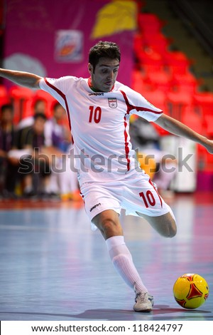 BANGKOK,THAILAND-NOVEMBER 05:Hossein Tayebi (white) of Iran in action during the FIFA Futsal World Cup between Morocco and Iran at Indoor Stadium Huamark on Nov5, 2012 in Bangkok,Thailand.