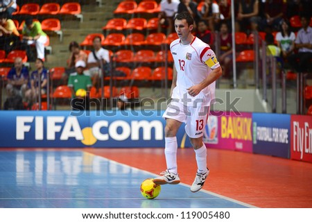 BANGKOK,THAILAND-NOVEMBER06:Islam Gamila of Czech Republic runs with the ball during the FIFA Futsal World Cup  between Egypt and Czech Republic at Indoor Stadium Huamark on Nov6, 2012 in,Thailand.