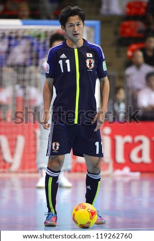 BANGKOK,THAILAND-NOVEMBER 07:Kazu Miura (blue) of Japan for  the ball during the FIFA Futsal World Cup between Japan and Libya at Indoor Stadium Huamark on Nov7, 2012 in,Thailand.