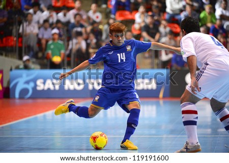 BANGKOK,THAILAND-NOVEMBER 07:Keattiyot Chalaemkhet of Thailand (blue)  for the ball during the FIFA Futsal World Cup between Paraguay and Thailand at Indoor Stadium Huamark on Nov7, 2012 in,Thailand.