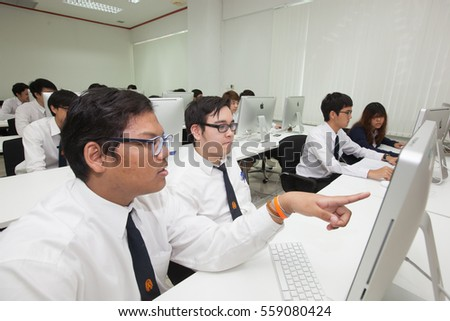 Bangkok, Thailand - November 17, 2015 :  King Mongkut's Institute of Technology  is a research and educational institution A class of students in front of their screens study computer science.
