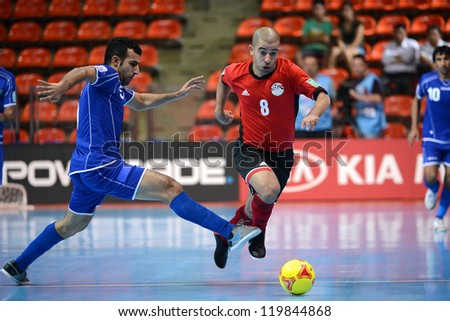 BANGKOK,THAILAND-NOVEMBER 09:Mizo of  Egypt (red) in action during the FIFA Futsal World Cup between Kuwait and Egypt at Indoor Stadium Huamark on Nov9,2012 in Bangkok,Thailand. - stock photo