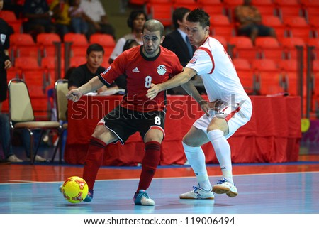 BANGKOK,THAILAND-NOVEMBER 06:Mizo (red) of Egypt for the ball during the national anthem the FIFA Futsal World Cup  between Egypt and Czech Republic at Indoor Stadium Huamark on Nov6,2012 in,Thailand. - stock photo