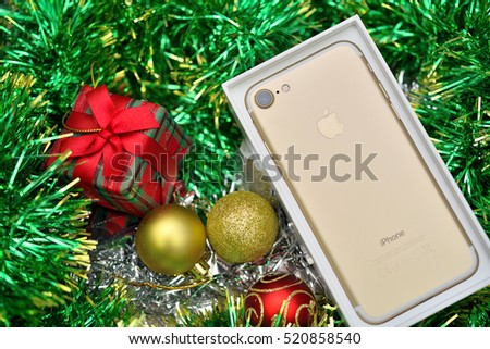 Bangkok, Thailand - November 23, 2016 : New Apple iPhone 7 unboxing in the first day of sales. New Apple iPhone acclaims to become the most popular smart phone in the world. iPhone 7 and red Gift Box.