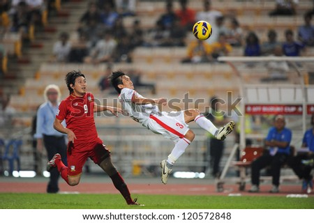 BANGKOK THAILAND-NOVEMBER 30:Nguyen Minh Duc of Vietnam ( white) in action during the AFF Suzuki Cup between Vietnam and Thailand at Rajamangala stadium on Nov30, 2012 in Bangkok,Thailand.