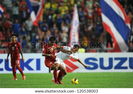 BANGKOK THAILAND-NOVEMBER 30:Nguyen Trong Hoang of Vietnam ( white) in action during the AFF Suzuki Cup between Vietnam and Thailand at Rajamangala stadium on Nov30, 2012 in Bangkok,Thailand.