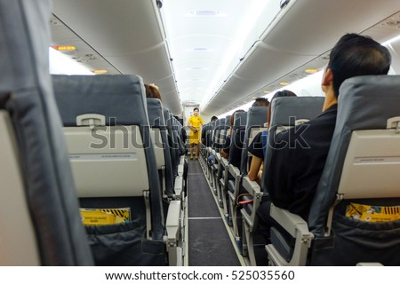 Bangkok, Thailand - November 4, 2016: Nok Air flight attendant is demonstrating safety equipment while on the plane. Before the plane soared into the skies.