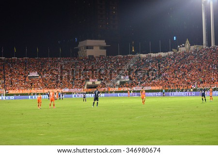 BANGKOK THAILAND-November 21: Players of Sisaket FC (orange) in action during football Toyota League cup between Sisaket FC and Buriram UTD. , at Supachalasai Stadium on November 21,2015:Thailand. - stock photo