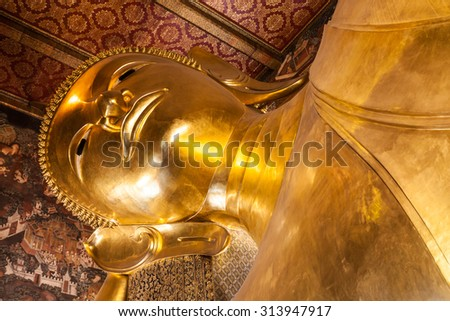 BANGKOK, THAILAND - NOVEMBER 09, 2014: Reclining Buddha head in Wat Pho Buddhist temple complex in Bangkok, Thailand.