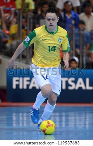 BANGKOK,THAILAND-NOVEMBER18:Rodrigo (yellow) of Brazil runs with the ball during the FIFA Futsal World Cup Final between Spain and Brazil at Indoor Stadium Huamark on Nov18, 2012 in,Thailand.