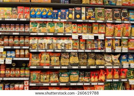 BANGKOK, THAILAND - NOVEMBER 19, 2013 : Selection of italian pasta on the shelves in a supermarket Siam Paragon, Bangkok. Siam Paragon is a one of the biggest shopping centres in Asia. - stock photo