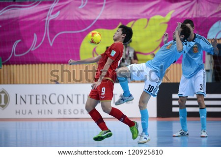 BANGKOK, THAILAND - NOVEMBER 11: Suphawut Thueanklang of Thailand (red) for  the ball during the FIFA Futsal World Cup  between Thailand and Spain at Nimibutr Stadium on Nov11, 2012 in,Thailand.