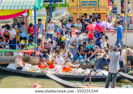 BANGKOK,THAILAND-November 1,2015 : Thai people give offerings to  Buddhist monks on Ok Phansa day(End of Buddhist Lent) in Ladkrabang, Bangkok,Thailand. - stock photo