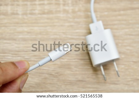Bangkok, Thailand - November 23, 2016 : The iPhone connecting with the charger cable.