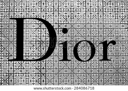 BANGKOK,THAILAND - NOVEMBER 18, 2013 : The sign of Dior at Dior store in Siam Paragon Mall in Bangkok. It is a French company controlled and chaired by Bernard Arnault who also heads Louis Vuitton. - stock photo