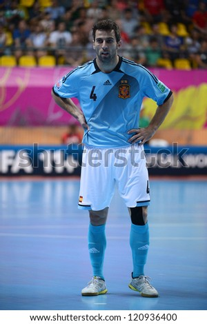 BANGKOK, THAILAND - NOVEMBER 11:Torras of Spain (blue) in action during the FIFA Futsal World Cup  between Thailand and Spain at Nimibutr Stadium on Nov11, 2012 in Bangkok,Thailand.
