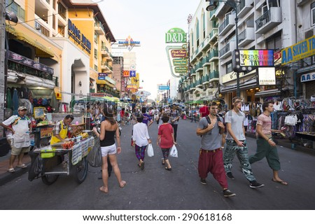 BANGKOK, THAILAND - NOVEMBER 16, 2014: Tourists and vendors share the pedestrianized street on a typical daytime scene in the backpacker center of Khao San Road.