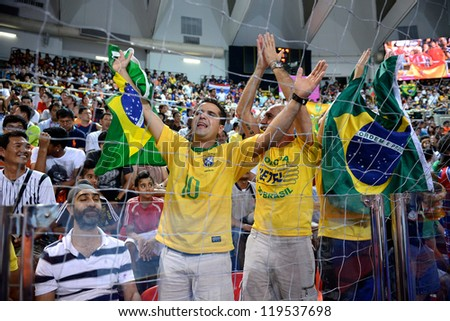 BANGKOK,THAILAND - NOVEMBER18:Unidentified fans of Brazil supporters  the FIFA Futsal World Cup Final between Spain and Brazil at Indoor Stadium Huamark on Nov18, 2012 in ,Thailand.