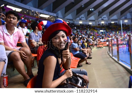 BANGKOK,THAILAND-NOVEMBER 04:Unidentified fans of thailand supporters  the FIFA Futsal World Cup between Thailand and Ukraine at Indoor Stadium Huamark on Nov4, 2012 in Bangkok, Thailand. - stock photo