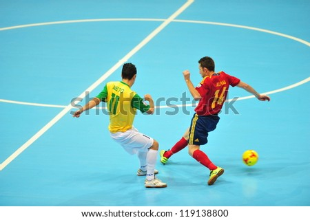 BANGKOK, THAILAND - NOVEMBER 18: Unidentified players in the FIFA Futsal World Cup Final between Spain (R) and Brazil (Y) at Indoor Stadium Huamark on November 18, 2012 in Bangkok, Thailand. - stock photo