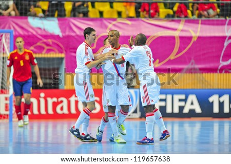 BANGKOK, THAILAND - NOVEMBER 14: Unidentified players in the FIFA Futsal World Cup, Quarter-Final match between Spain and Russia at Nimibutr Stadium on November 14, 2012 in Bangkok, Thailand. - stock photo