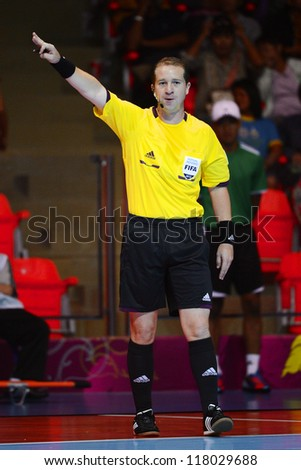BANGKOK,THAILAND-NOVEMBER 3:Unidentified Referee in action during the FIFA Futsal World Cup between Czech Republic and Kuwait at Indoor Stadium Huamark on Nov3, 2012 in Thailand. - stock photo