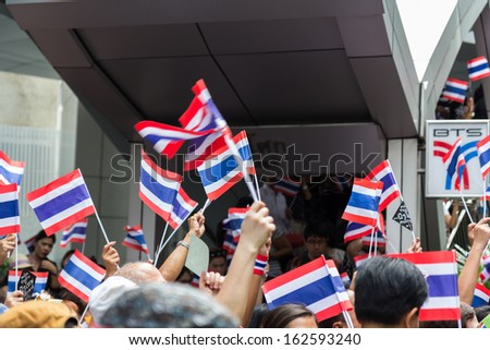BANGKOK,THAILAND - NOVEMBER 7, 2013 : Unidentified Thai people, students, and few foreigner protest against the disputed amnesty act in Asoke junction and the BTS Elevated train station, Bangkok