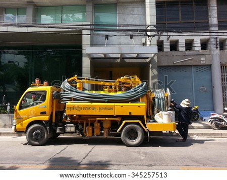 Bangkok, Thailand - November 30, 2015: Yellow truck to suck sewage service park in front of the building to provide services.