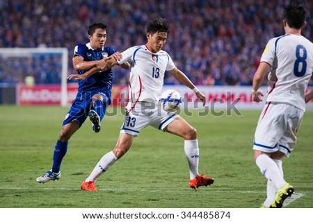 BANGKOK,THAILAND NOVEMBER 12:Yen Ho-shen no.13(R)of Chinese Taipei  in action during the 2018 FIFA World Cup Qualifier Thailand and Chinese Taipei  at Rajamangala Stadium on Nov 12, 2015 in Thailand. - stock photo