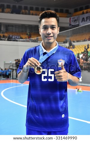 BANGKOK THAILAND-OCT16:Ampol Srirageaw celebrates winning the gold medal. 2015 AFF Futsal Championship Match between Thailand and Australia at Bangkok Arena Stadium on October16,2015 in Thailand