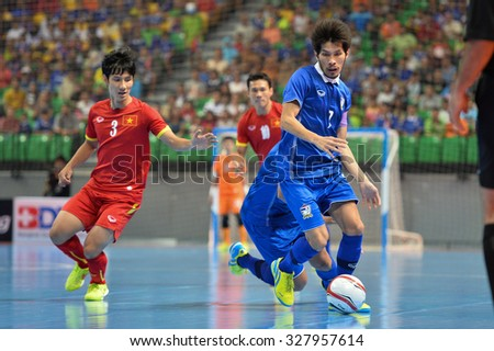 BANGKOK THAILAND-OCT14:Ampol Srirageaw of Thailand in action during 2015 AFF Futsal Championship Match between Thailand and Vietnam at Bangkok Arena Stadium on October14,2015 in Thailand