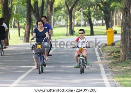 BANGKOK THAILAND -Oct. 14- group of bikers are riding bikes in bicycle lanes of at the Vachirabenjatas Park (Rot Fai park) of Bangkok on October 14 ,2014 in Bangkok, Thailand  - stock photo