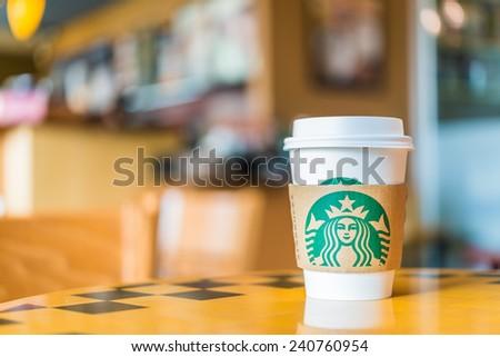 Bangkok ,Thailand- OCT 30 : Hot coffee cup Blended Beverages served at wood table in starbuck shop at Central Department store Rattatibet , Bangkok, Thailand. - stock photo