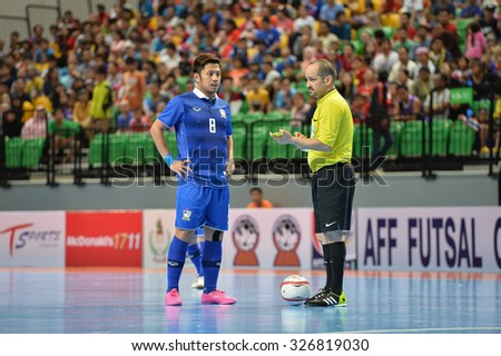 BANGKOK THAILAND-OCT11:Jetsada Chudech(Blue) of Thailand in action during 2015 AFF Futsal Championship Match between Thailand and Brunei at Bangkok Arena Stadium on October11,2015 in Thailand