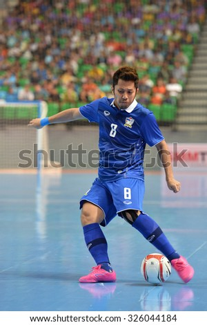 BANGKOK THAILAND-OCT9:Jetsada Chudech of Thailand in action during 2015 AFF Futsal Championship Match between Thailand and Singapore at Bangkok Arena Stadium on October9,2015in Thailand
