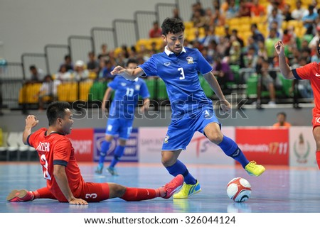 BANGKOK THAILAND-OCT9:Konghla Lhekhla(Blue) of Thailand in action during 2015 AFF Futsal Championship Match between Thailand and Singapore at Bangkok Arena Stadium on October9,2015in Thailand