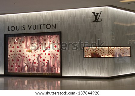 BANGKOK, THAILAND - OCT 11: Louis Vuitton store in Siam Paragon Mall on Oct 11th 2012 in Bangkok. Opened in July, this is LV's 4th store in Bangkok. - stock photo