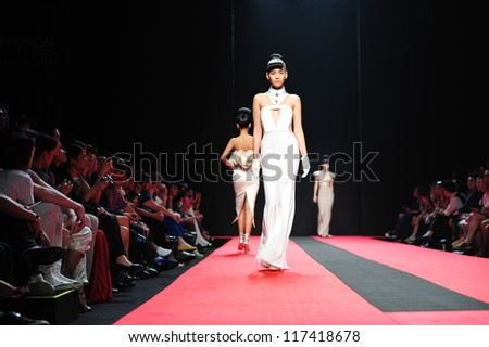 "BANGKOK, THAILAND - OCT 13 : Model walks the runway at "" Hooks "" collection presentation during ELLE Fashion Week 2012 on October 13, 2012 in Bangkok Thailand."