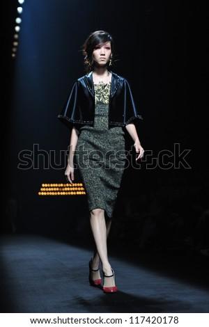 "BANGKOK, THAILAND - OCT 13 : Model walks the runway at "" Purinutt "" collection presentation during ELLE Fashion Week 2012 on October 13, 2012 in Bangkok Thailand. - stock photo"