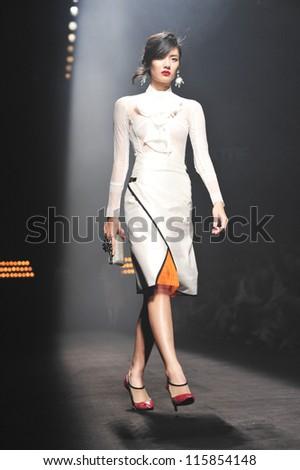 "BANGKOK, THAILAND - OCT 12 : Model walks the runway at "" Theatre "" collection presentation during ELLE Fashion Week 2012 on October 12, 2012 in Bangkok Thailand. - stock photo"
