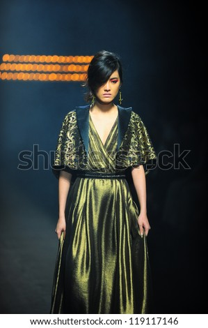 "BANGKOK, THAILAND - OCT 12 : Model walks the runway at "" Theatre"" collection presentation during ELLE Fashion Week 2012 on October 12, 2012 in Bangkok Thailand."