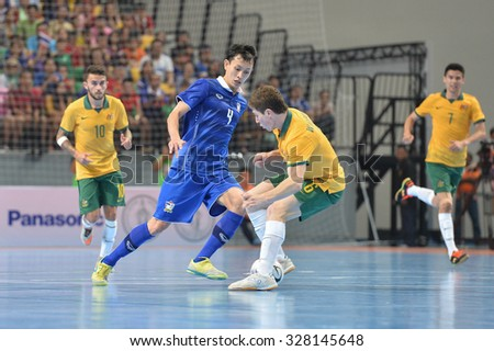 BANGKOK THAILAND-OCT16:Piyapan Rattana(Blue) of Thailand in action during 2015 AFF Futsal Championship Match between Thailand and Australia at Bangkok Arena Stadium on October16,2015 in Thailand